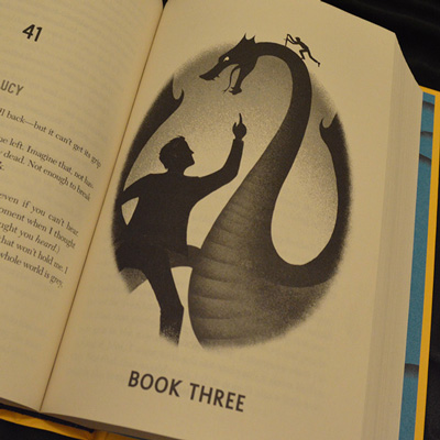 Carry On - black and white illustration of Simon and Baz fighting a dragon