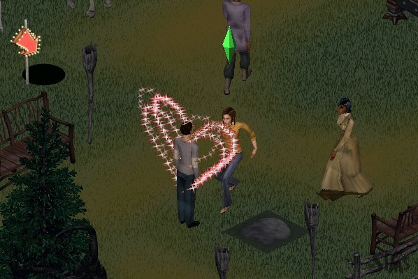 Suzie casting a spell on Mark, he is standing there with magical sparkles forming a heart around him